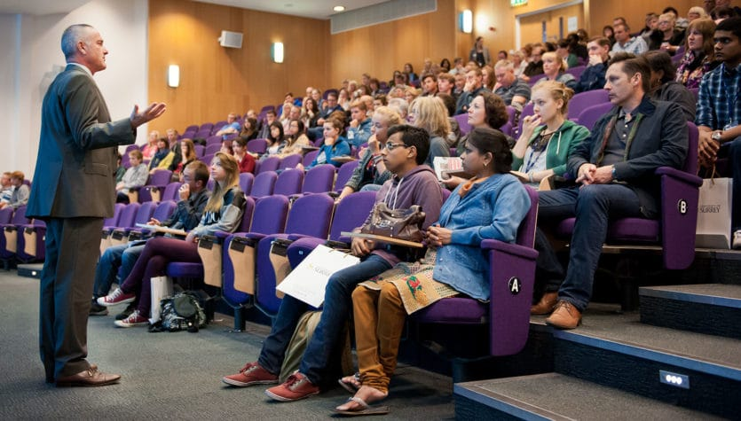Students in a lecture hall at the University of Surrey